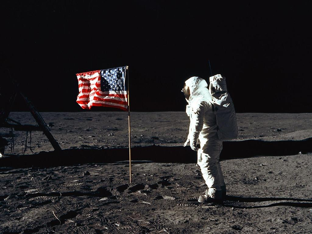 Astronaut Edwin E. Aldrin Jr., lunar module pilot of the first lunar landing mission, poses for a photograph beside the deployed United States flag. Picture: NASA