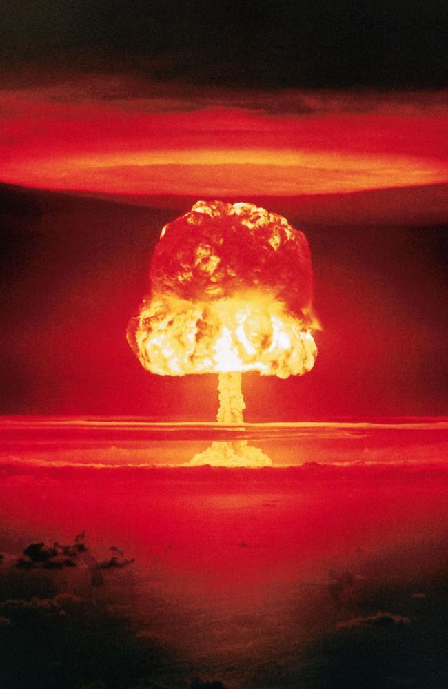 Mushroom cloud rising from the detonation of an 11-megaton nuclear device bomb 'Romeo' over Bikini Atoll in the Marshall Islands.