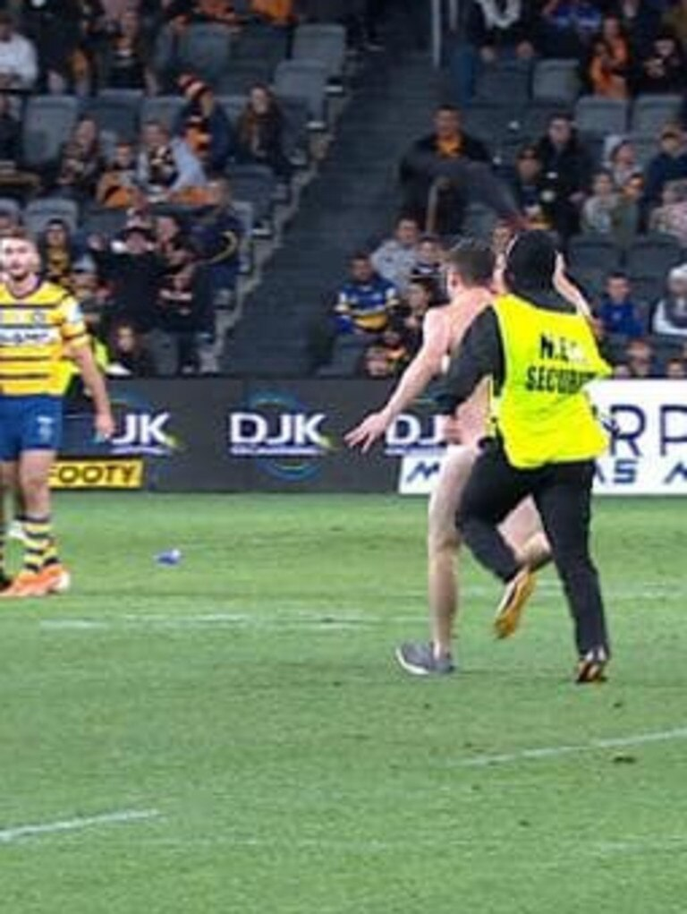 Matthew Cooper was given a court attendance notice for streaking during Eel's Tiger Clash at Bankwest Stadium