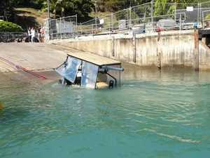 Police divers recover a stolen golf buggy at Hamilton Island on Wednesday.