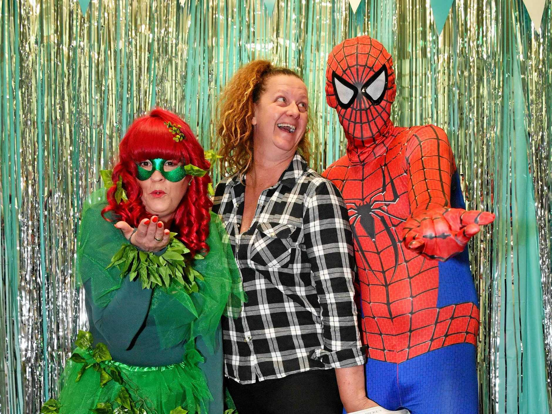 POWERS ON POINT: Superheroes Samantha Hope, Janelle Wright and Dave Figg warm up for the carnival fundraiser at Kings Beach Tavern.