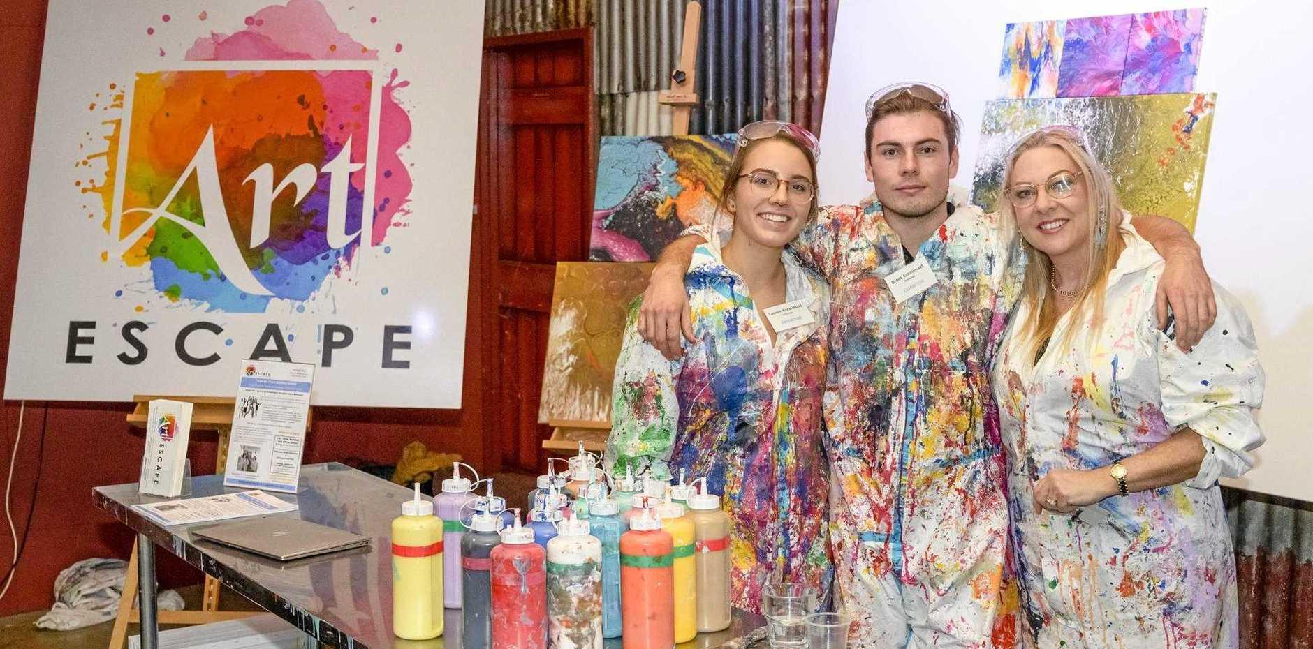 COLOUR SPLASH: Lauren Dumont, Brock Kraaijmaat and Willeke Kraaijmaat of Art Escape, one of the newest creative business on the streets of Caloundra.