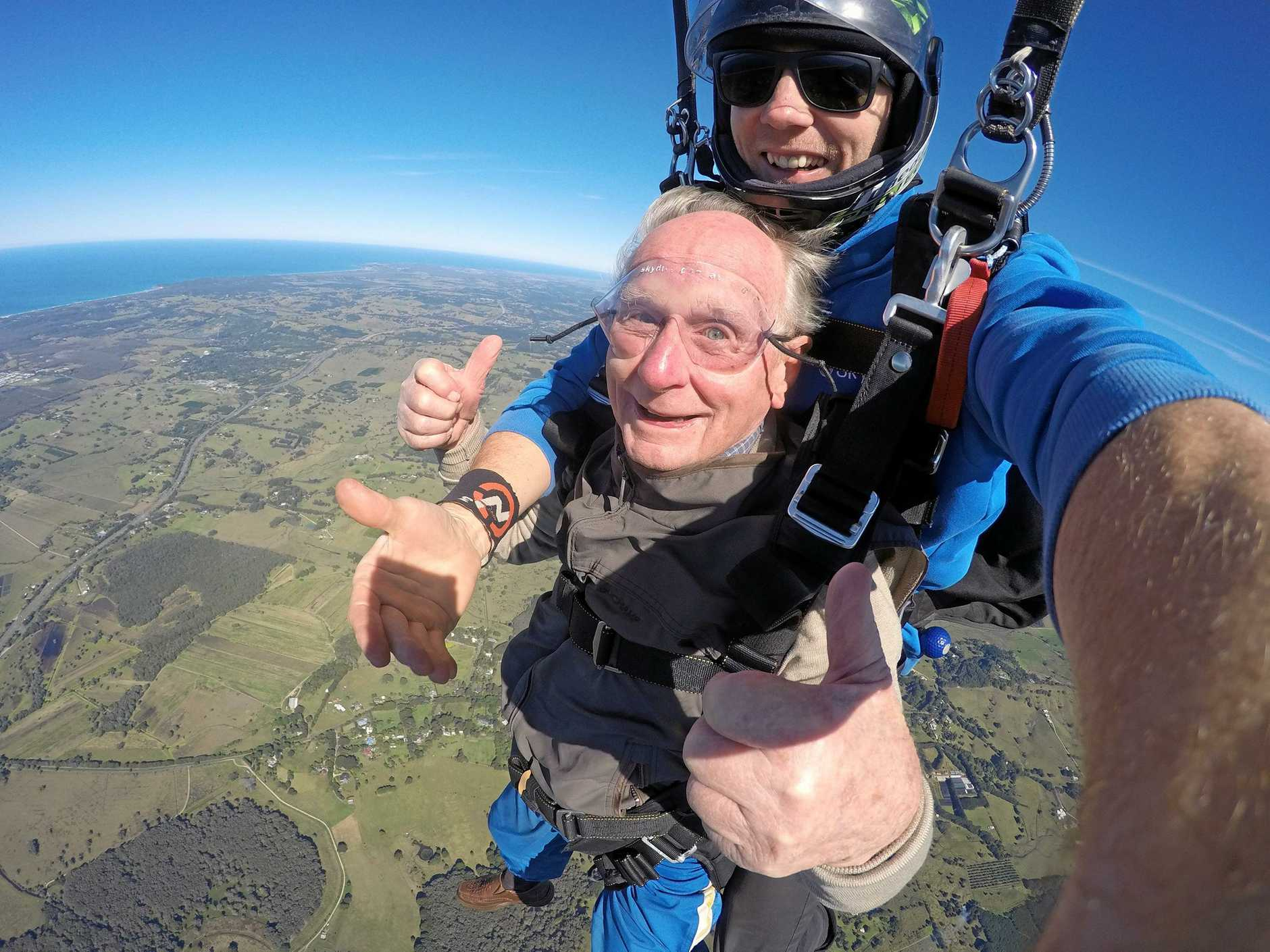 NEVER TOO OLD: Jock Rose, 90, takes to the sky over Byron Bay to tick skydiving off his bucket list.