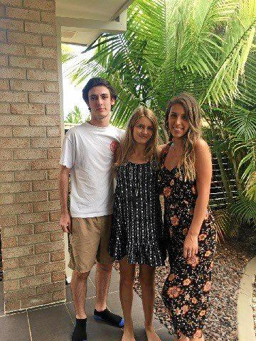 MOURNING: Jake Moore, 21, left, died after a tragic incident on a hinterland road and was found by motorists early Wednesday morning. He's pictured here with his sisters, Stephanie, right, and Rachel, centre.