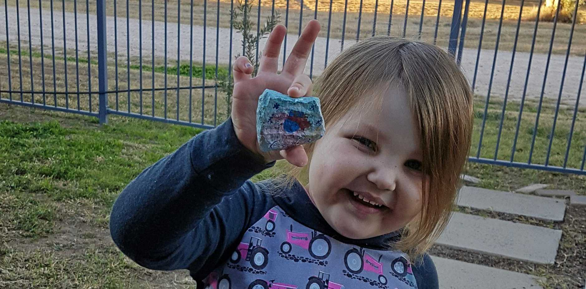 ROMA ROCKS: Three-year-old Skylynn Crosbie was ecstatic to find one of the painted rocks at Woolworths.