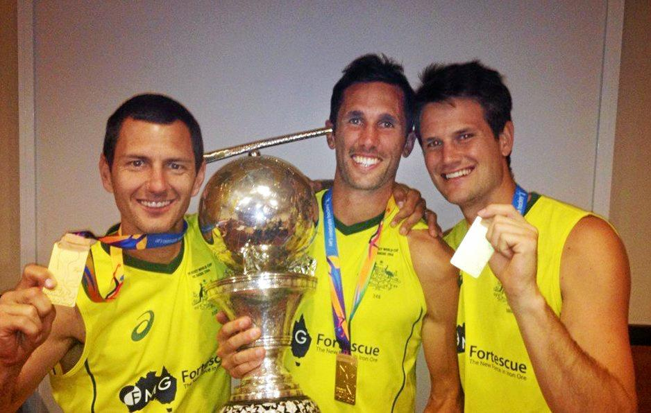 Jamie Dwyer, Mark Knowles and Matt Ghodes with the Hockey World Cup.