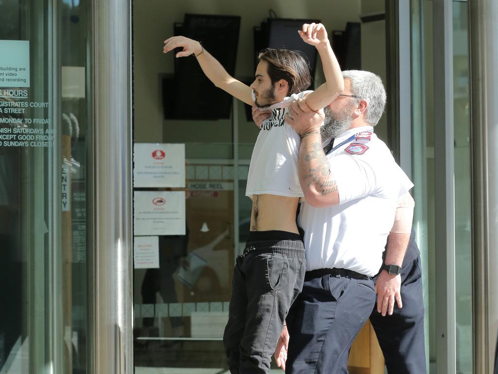 Extinction Rebellion spokesman and environmental activist Eric Herbert protesting outside the arrest court on July 11.