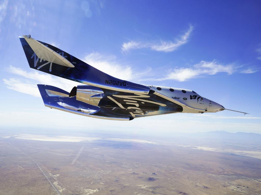 This May 29, 2018 photo provided by Virgin Galactic shows the VSS Unity craft during a supersonic flight test. The spaceship isn't launched from the ground but is carried beneath a special aircraft to an altitude around 50,000 feet (15,240 meters). There, it's released before igniting its rocket engine and climbing. Picture: Virgin Galactic via AP