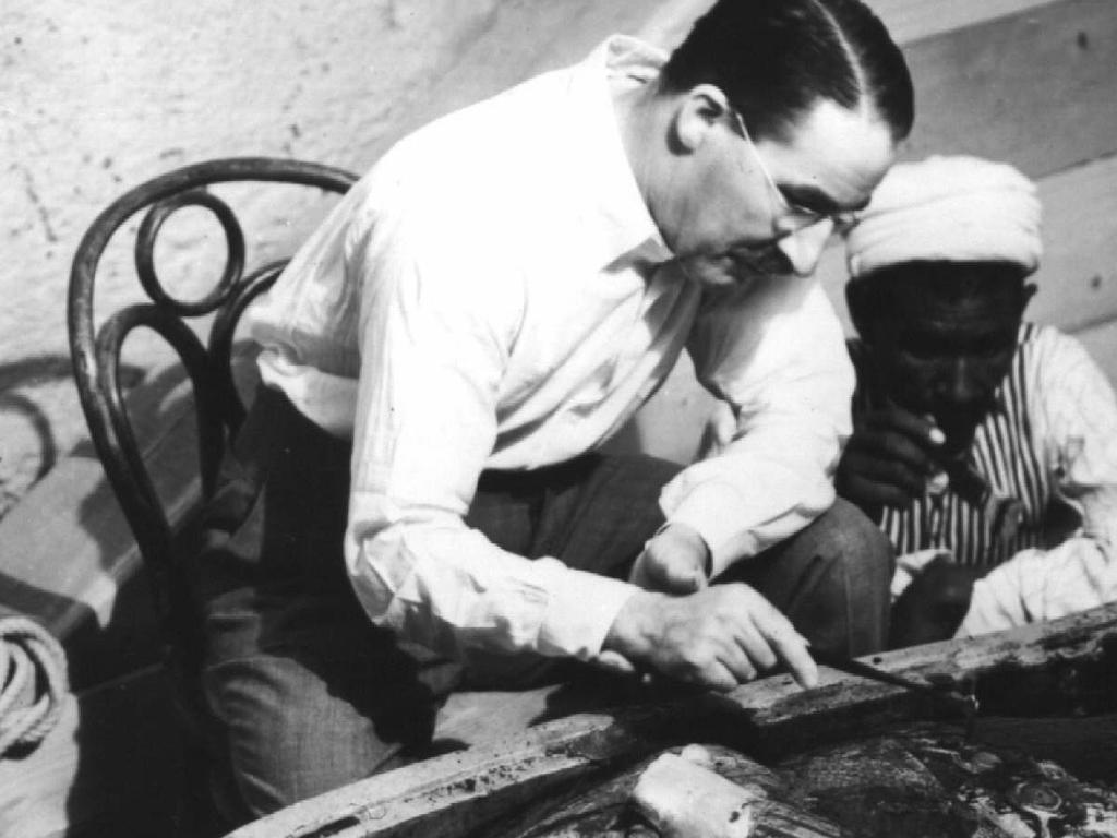 Archaeologist Howard Carter examining King Tutankhamen's mummy, 1922. Picture: Supplied