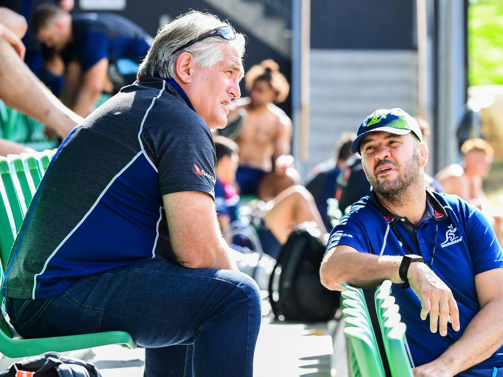 Rugby Australia director of rugby Scott Johnson (left) talks with Wallabies coach Michael Cheika in Johannesburg. Picture: Stu Walmsley/Rugby Australia Media.