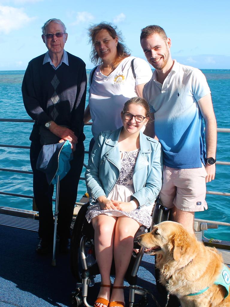 Erin Condrin (bottom) with her assistance dog Lacey on Sunlover Reef Cruises' pontoon at Moore Reef.