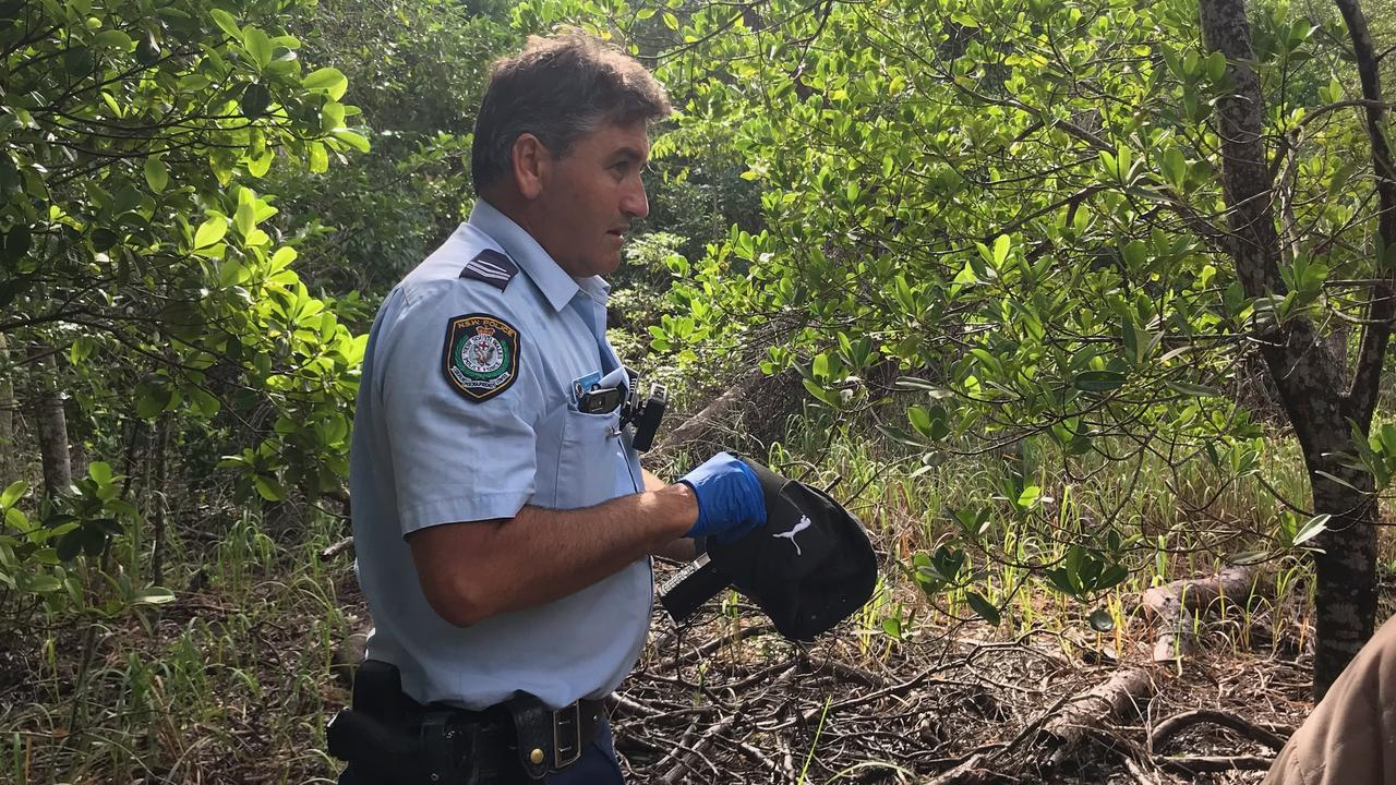 Constable Shane Lawson with the cap, similar to one owned by missing backpacker Theo Hayez. Picture: Jane Hanson