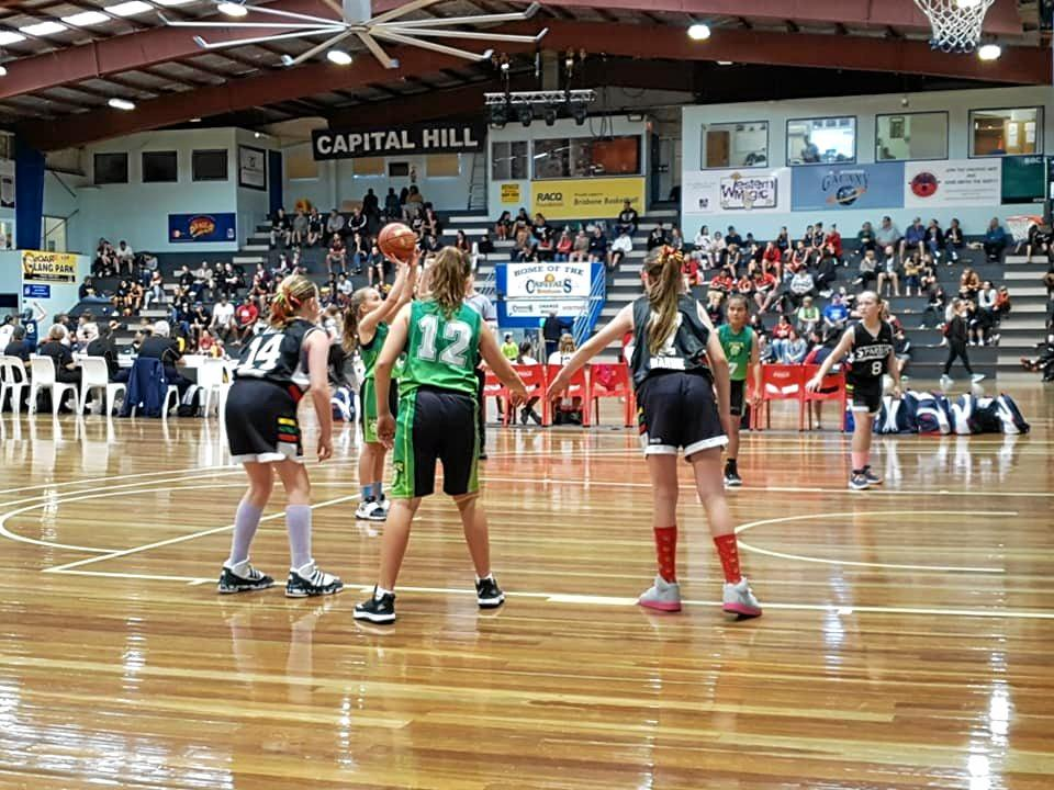 SURPRISE PACKETS: Emerald's Bre Walsh shoots a free throw with her team mates Abbey Denyer and Gwen Stevens lining up in the key.