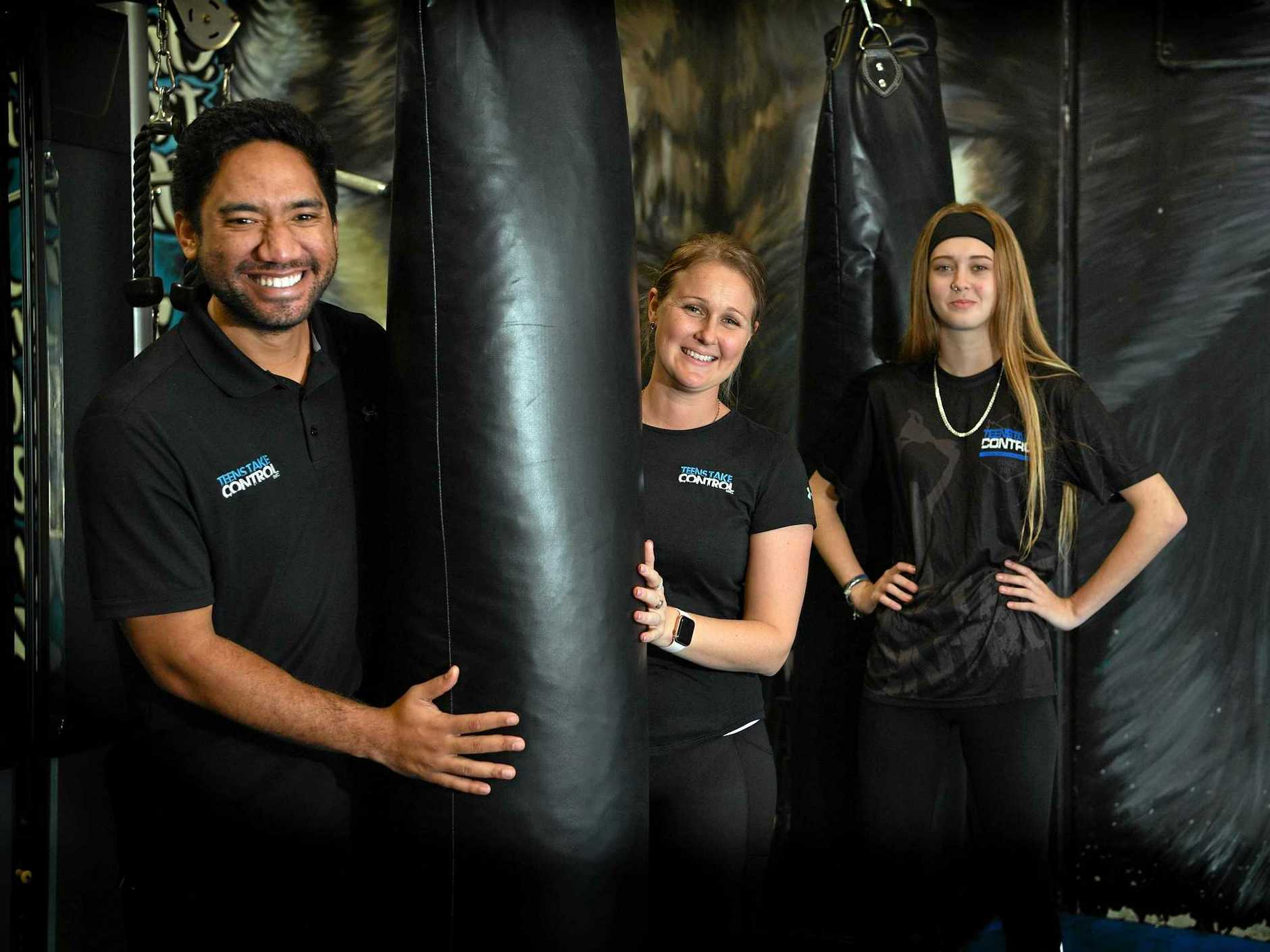 TEENS TAKE CONTROL: Lily Jackson has empowered herself through Core Strength Fitness after her life spiralled out of control. Lily (centre) with Tipoki Nepson-Taunoa and Asha Lumsden.