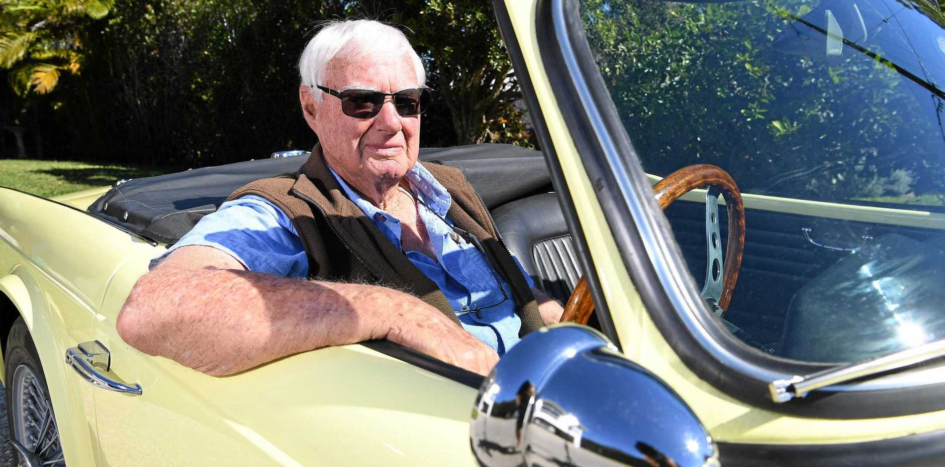 FOR THE LOVE OF CARS: Bob Wagg with his 1962 Triumph TR4 two-seater Roadster.