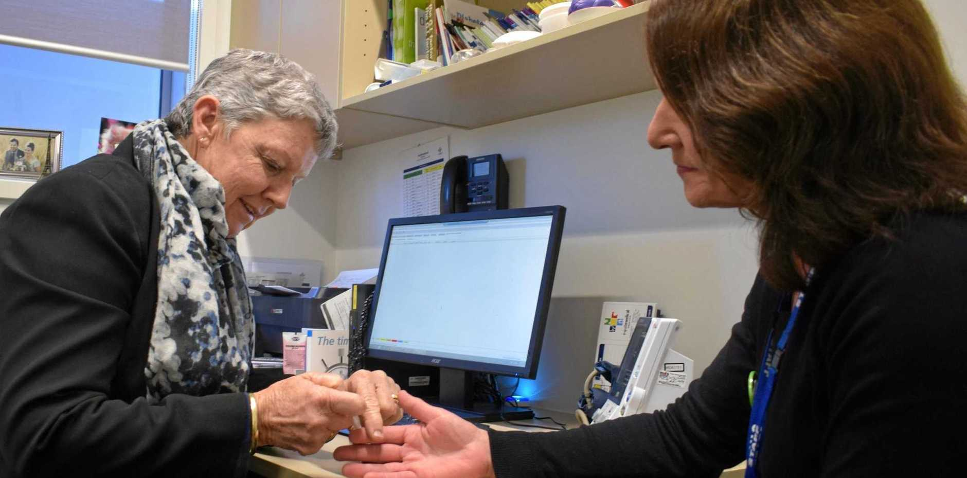 CHECKING UP: Credentialled Diabetes Educator Lyn Wilkie tests a colleague's blood sugar in the name of diabetes education in the bush.