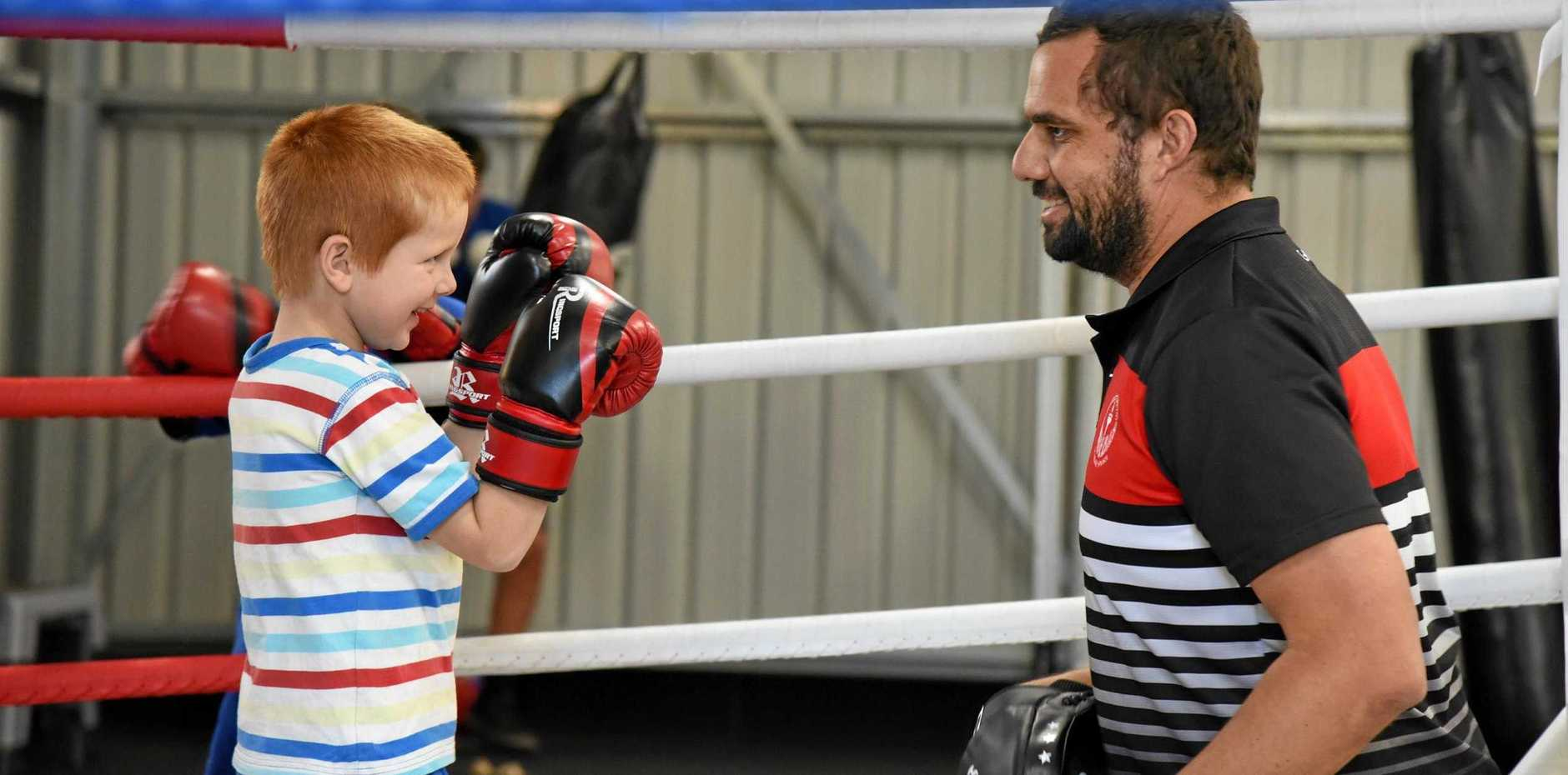 IN THE RING: Eidsvold Boxing Club trainer Preston Parter with William Murray.
