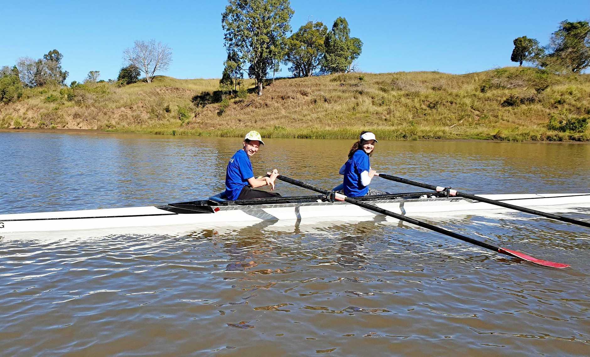 ENTHUSIASTIC: Members of the Lower Clarence Rowing Club in Brisbane last weekend.
