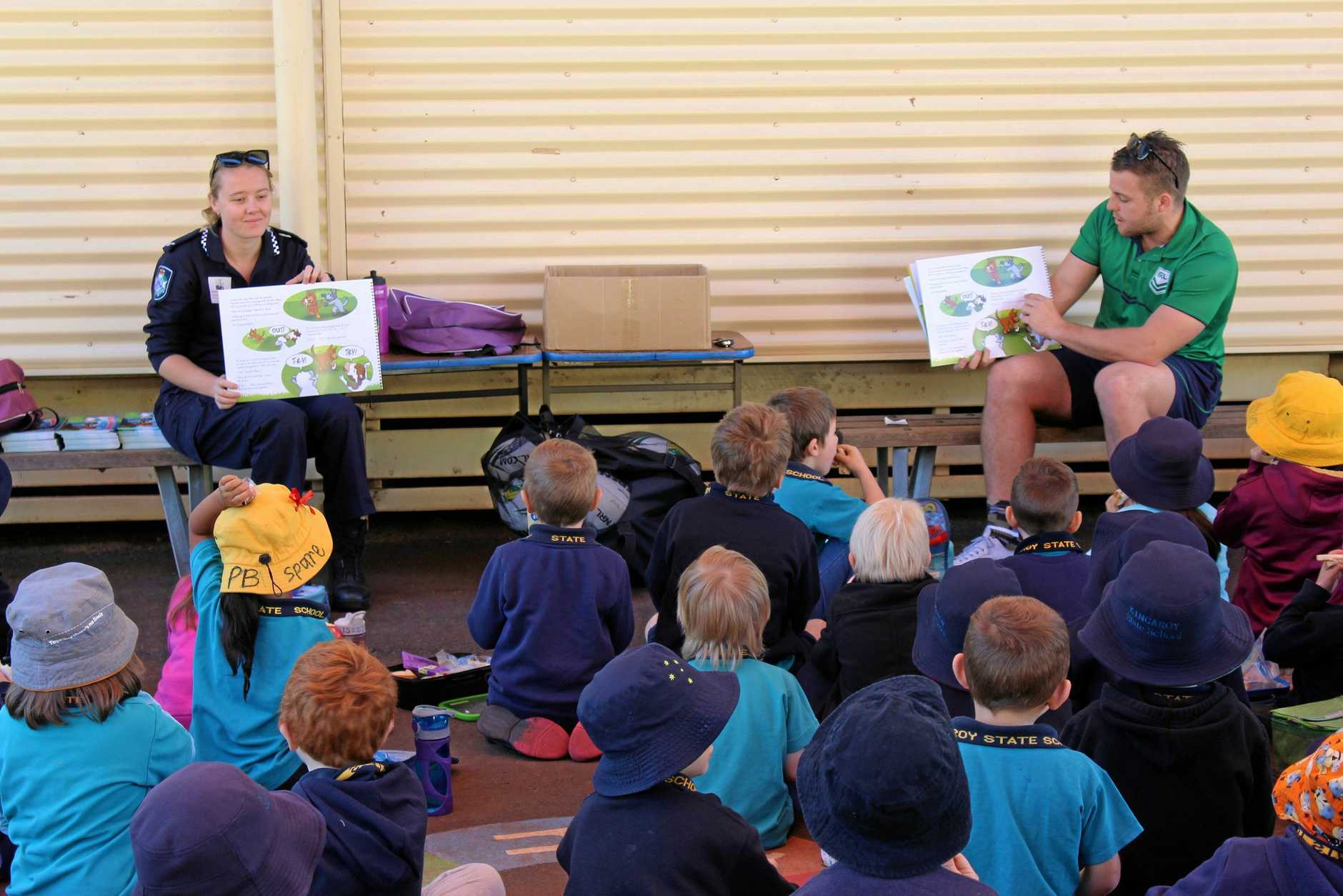 TIME FOR A STORY: Constable Knight and Blake Mara were special story time guests at schools around the South Burnett this week.