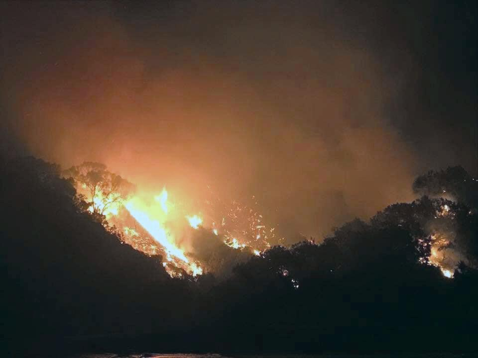 Images of the bushfire currently burning in the Great Sandy National Park near Teewah Camp Ground.