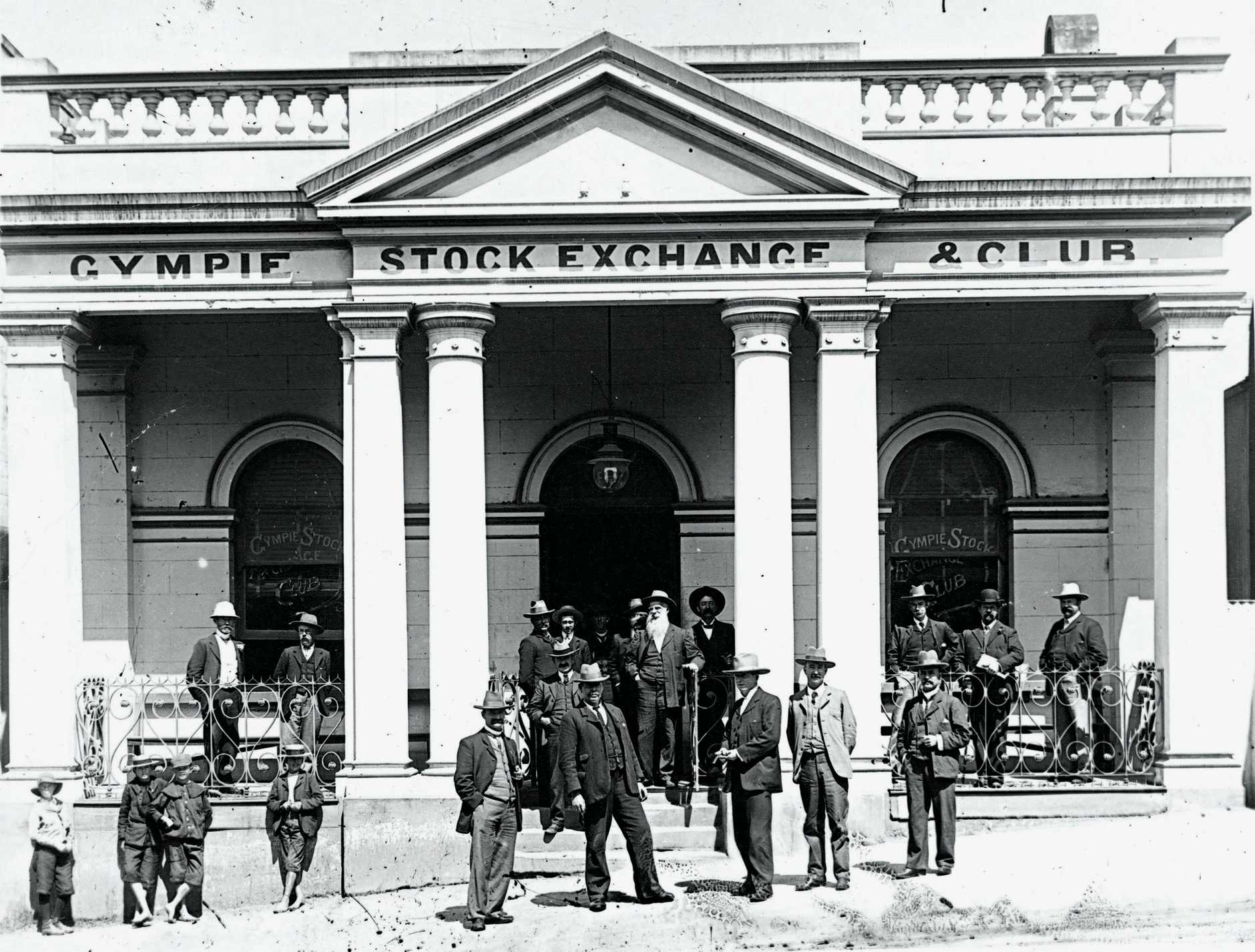 Members - and urchins - outside the Gympie Stock Exchange Club.Attribution: State Library of Queensland