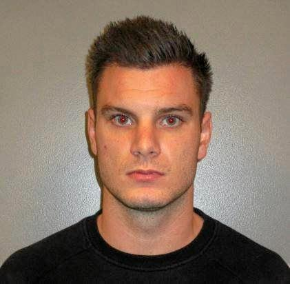 Kye Enright, 21, is wanted on an outstanding Queensland warrant, after a man died in the carpark of a business on Laidley Plainland Road, Plainland. He could be in Northern NSW.
