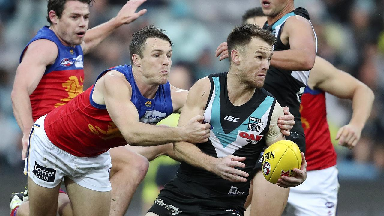Lincoln McCarthy stops Robbie Gray from getting away. Picture: Sarah Reed