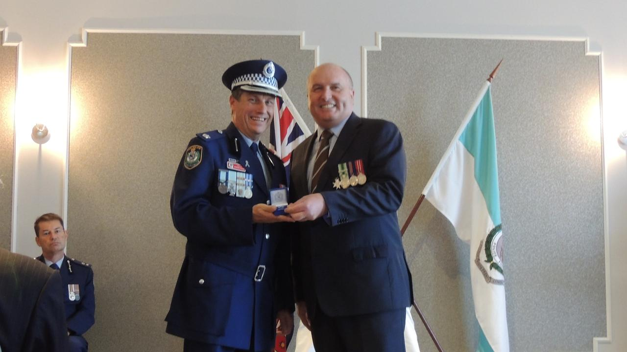Inspector Stephen Fowler (left) receives his NSW Police Medal 35 year clasp from Baulkham Hills state Liberal MP and Minister David Elliott