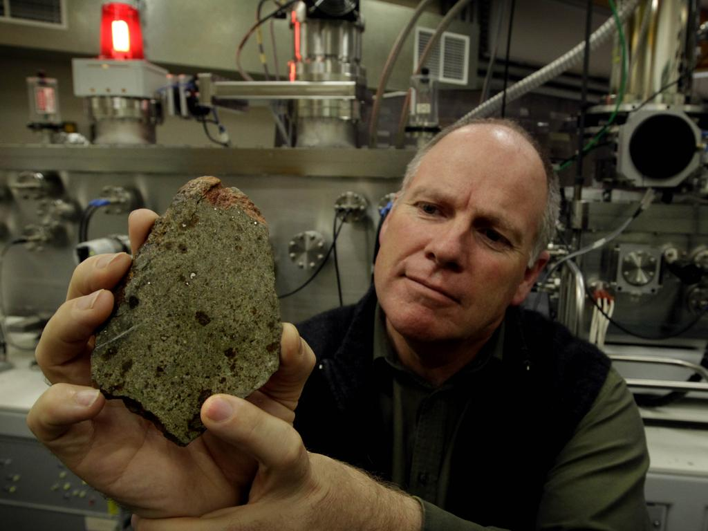 Cosmochemist Professor Trevor Ireland, shows off a meteorite sample. He continues to examine the space rocks brought back by the Apollo team. Picture: Supplied