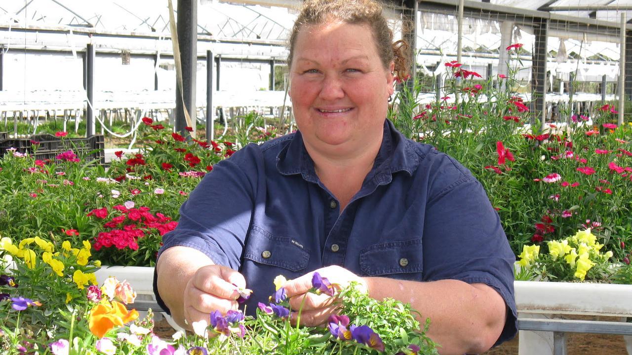 Kym Samuelsen picks edible flowers at Ghost Gully Produce.