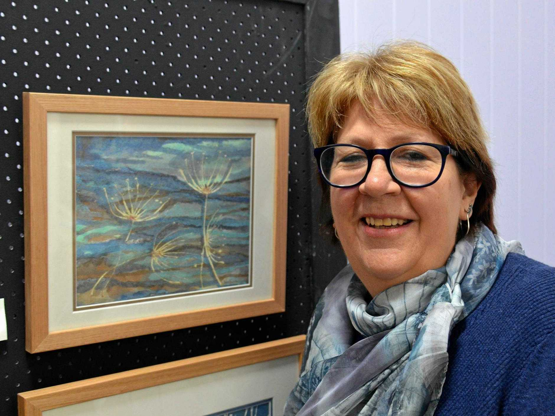 Noelene Luck with her painting 'Condamine Walk'.