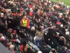 Two arrested after violence at Crows-Bombers game