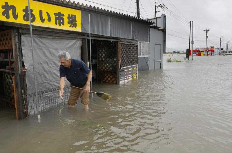 A shop in Tosu in Saga Prefecture, southwestern Japan, is submerged due to heavy rain on July 21, 2019.
