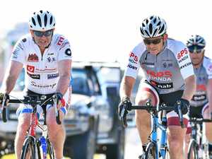 Lycra-clad Tony Abbott rolls into Sunshine Coast
