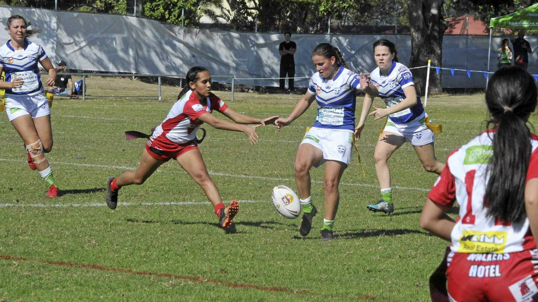TOO STRONG: Rebels' Karri Williams smothers an Elle Moss kick for the Ghosts.
