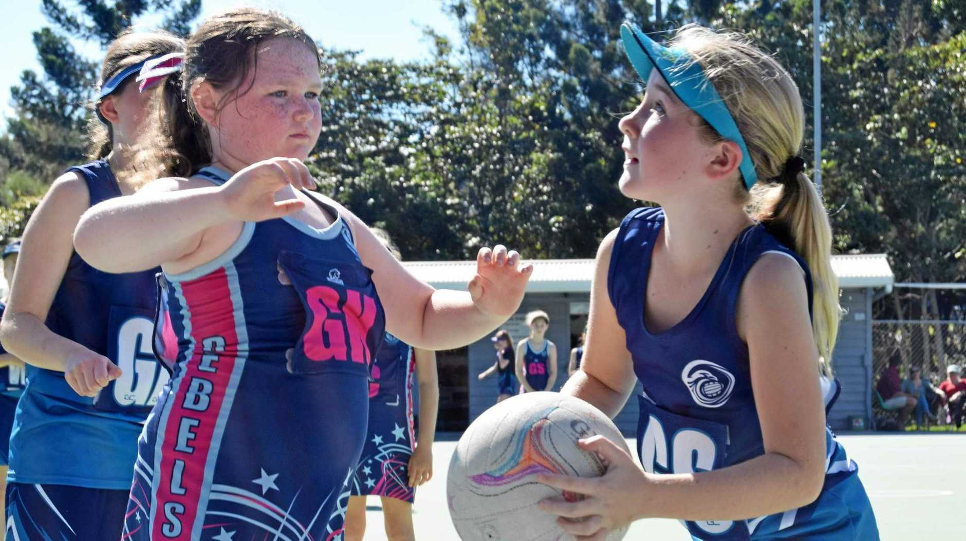 ON A ROLE: Grace Kelleher in attacking position about to score a point in the netball under 12s carnival held in Gympie today.