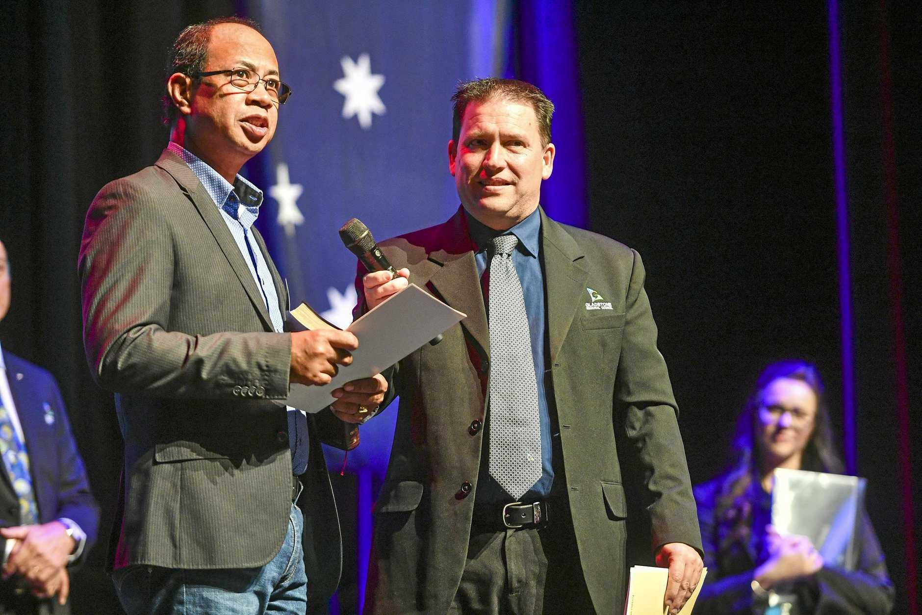 Onofre Estoya, with Mayor Matt Burnett, was one of 52 who took the citizenship pledge last Friday.