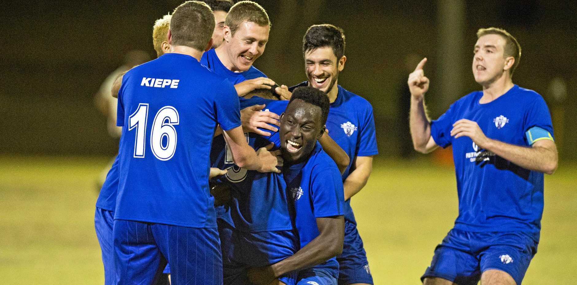 SHIELD WINNERS: Rockville celebrate Patrick Maneikera's goal. Jefferson Oliveira's injury time goal sealed a 2-1 win for Rockville over Willowburn in the Winstanley Shield clash on Saturday.