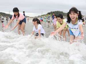 Fukushima beach reopens for swimming