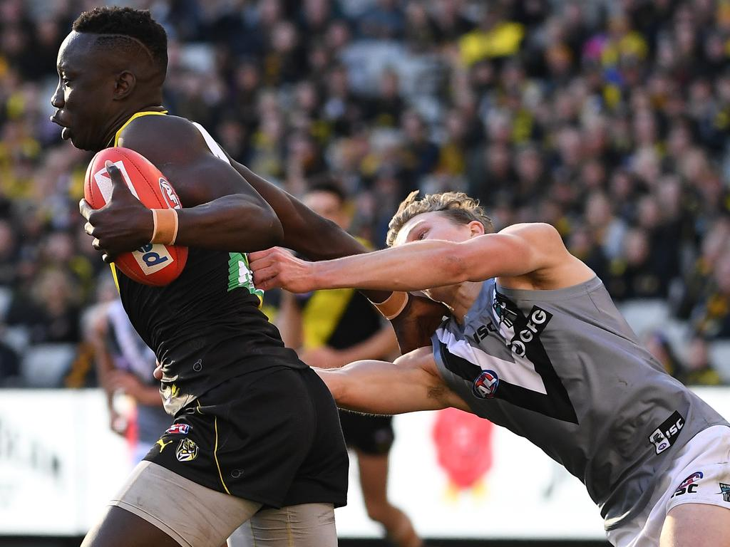 Mabior Chol tries to evade a tackle from Xavier Duursma.