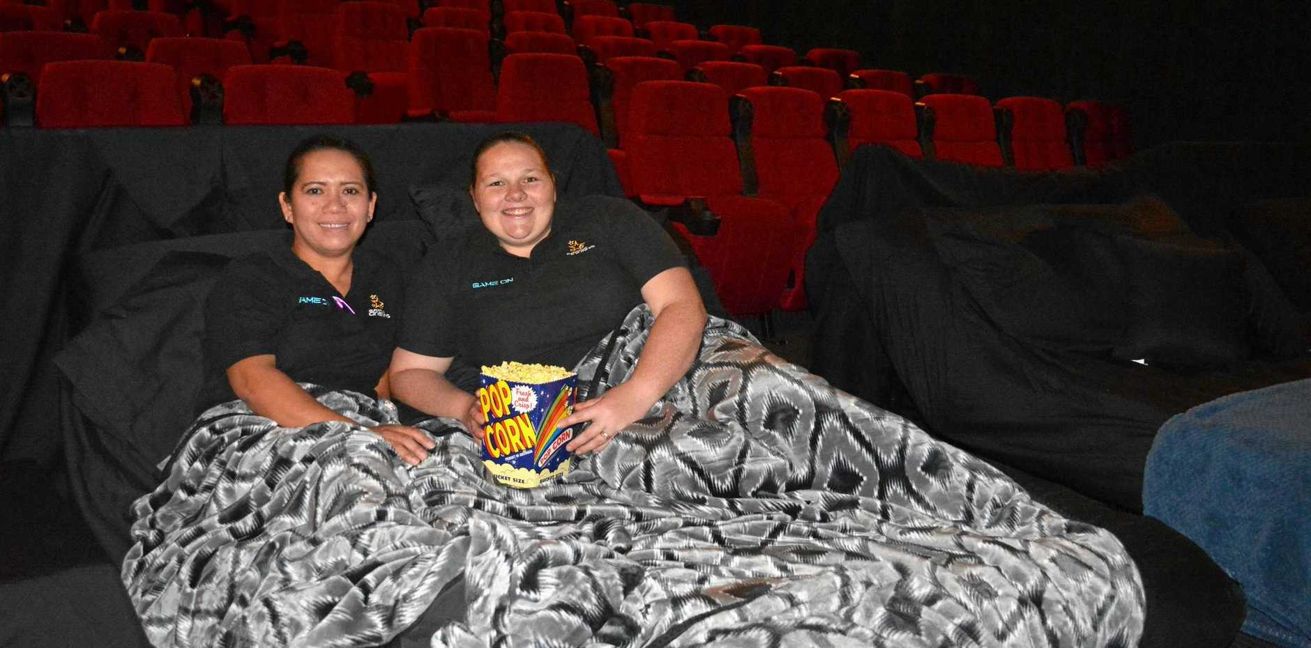 Gladstone Cinemas staff Joanne Tierney and Samantha Roberts try out the new big screen cinema beds.