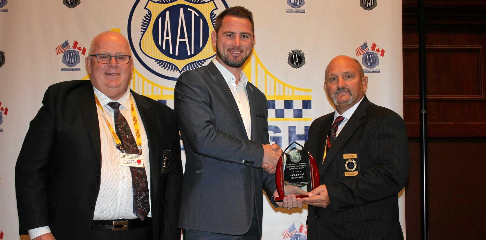 MAKING STRIDES: John Borland receiving his world award.