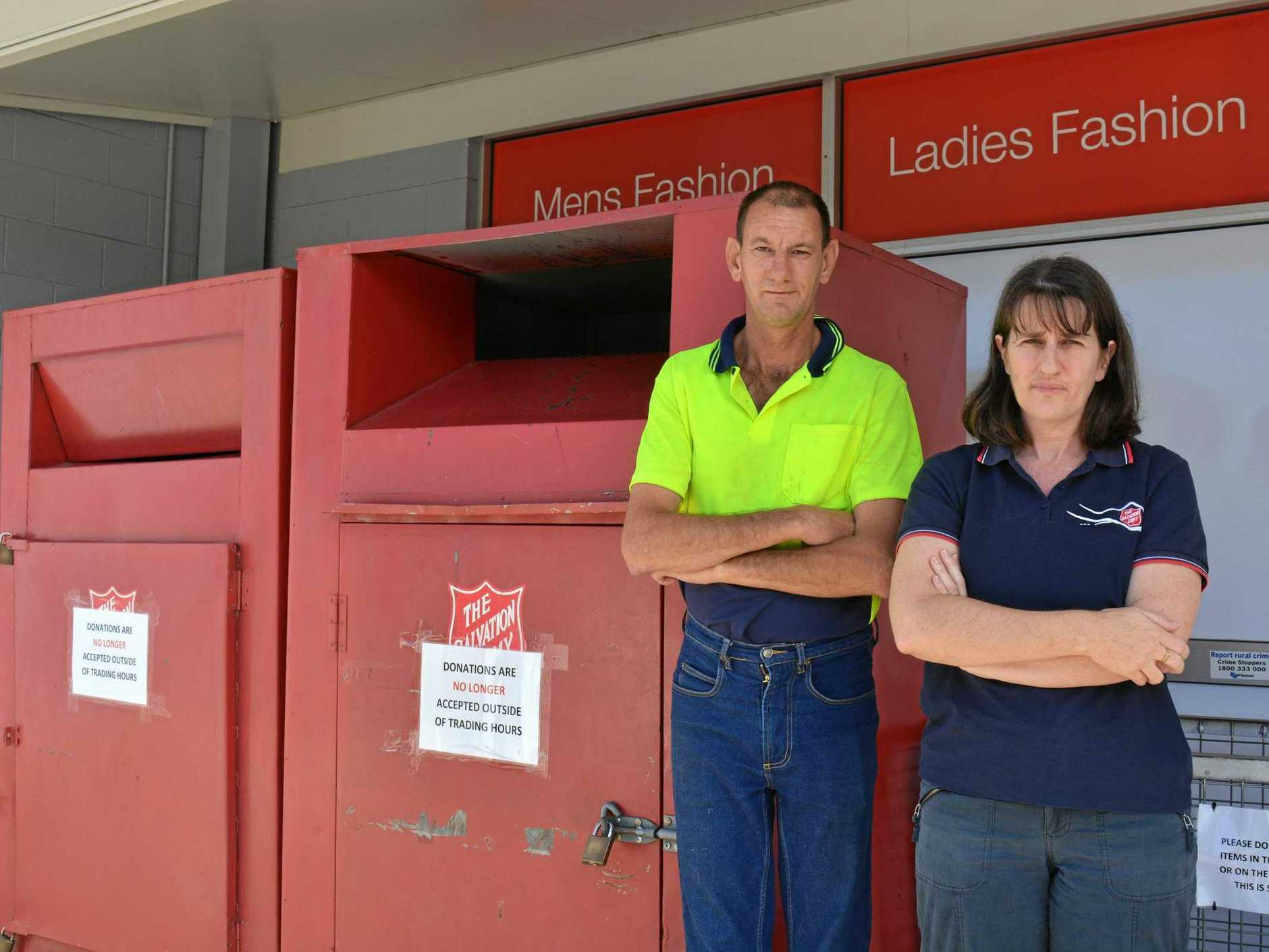 FED UP: Store volunteer Micheal McNamara and lieutenant Kay Ford are not happy with the amount of rubbish being dumped in the Salvation Army's donation bins.