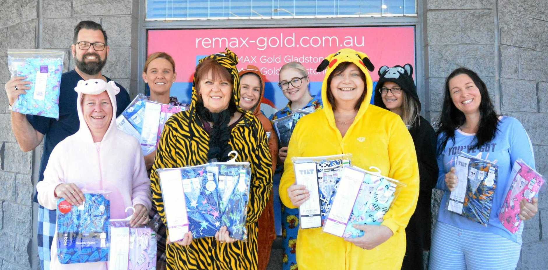 RUGGED UP: RE/MAX Gold Gladstone staff members participated in National Pyjama Day.