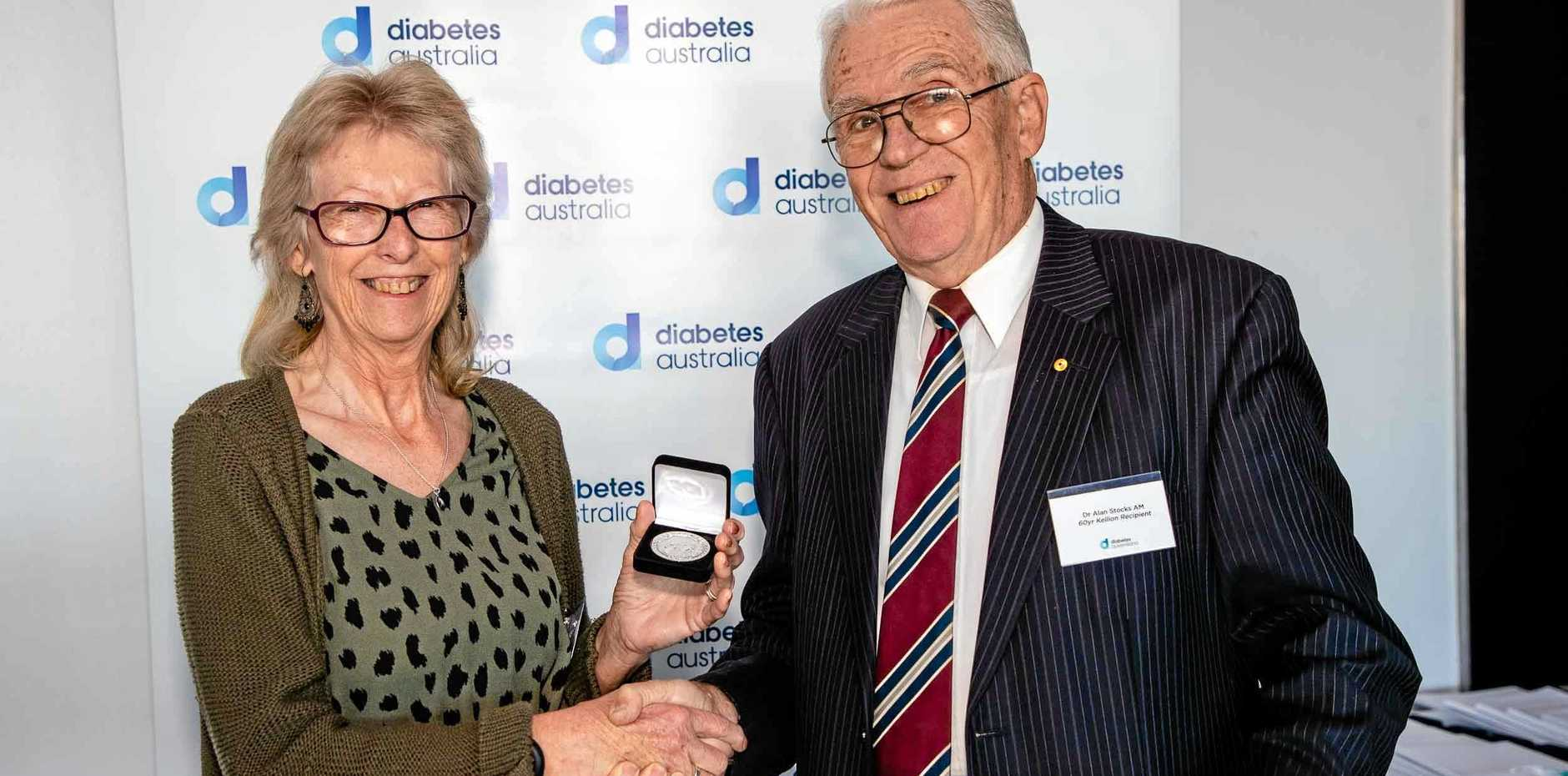 LIFE OF RESILIENCE: Poona resident Nicola Alletag is presented with her Kellion Medal for living with type-1 diabetes for 50 years by Dr Alan Stocks AM. Maryborough resident Naomi Richardson was also presented with the same accolade.