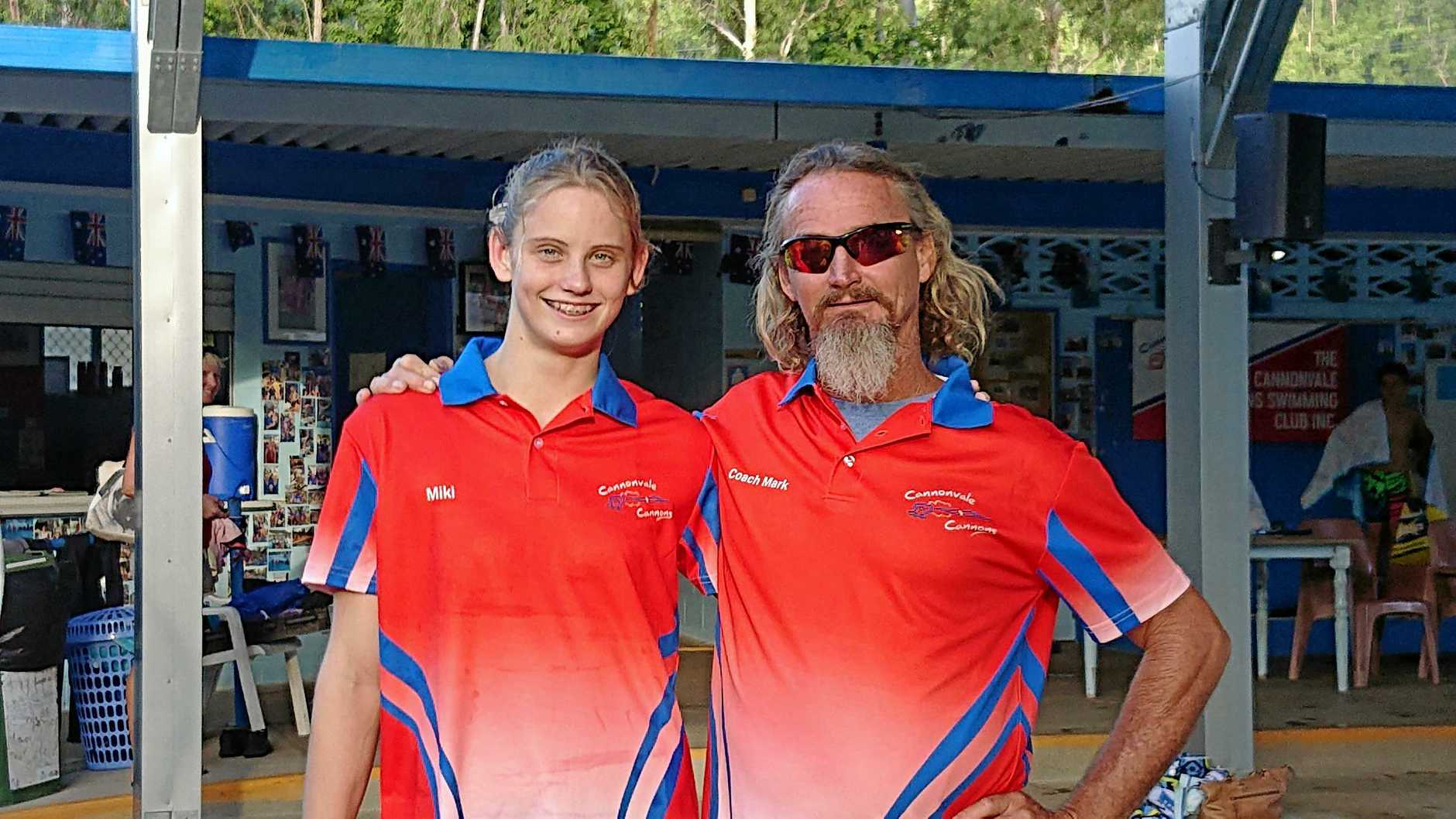 IN FORM: Cannonvale Cannons swimmer Mikhaila Flint and coach Mark Erickson.