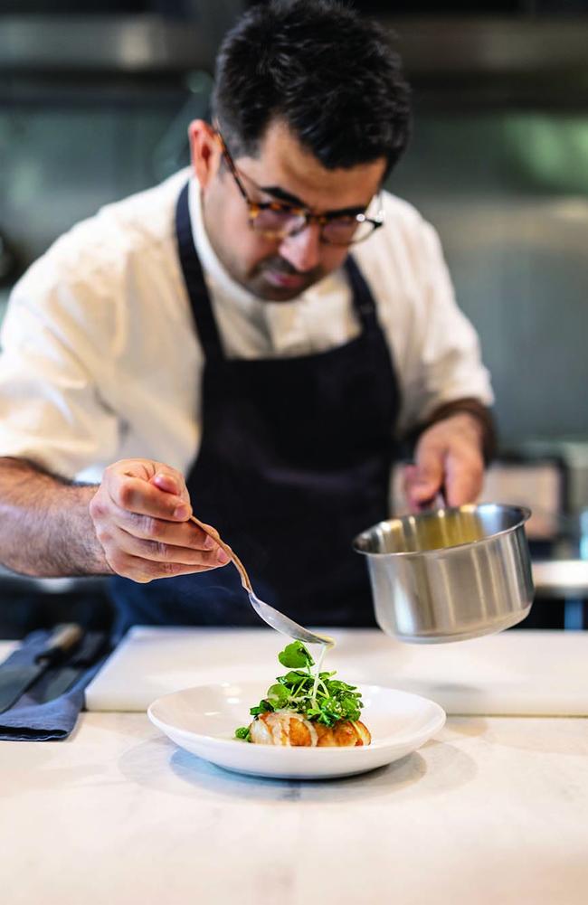 Chef Alex Munoz finishes at dish at Labart. Photo: Jeff Camden