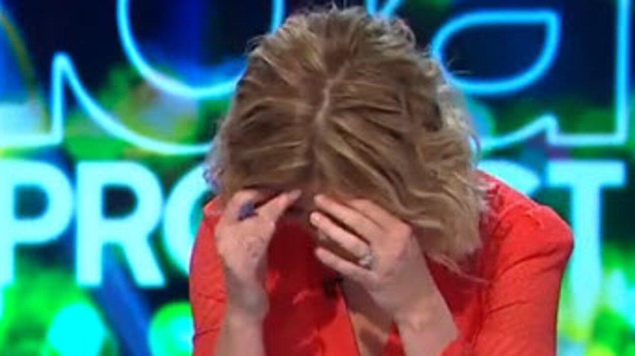 Sarah buries her head in her hands.