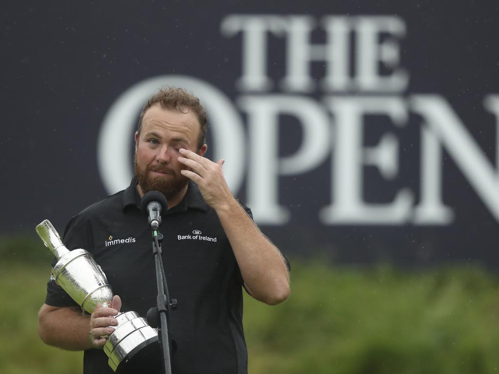 Ireland's Shane Lowry wipes away a tear as he makes a speech. (AP Photo/Jon Super)