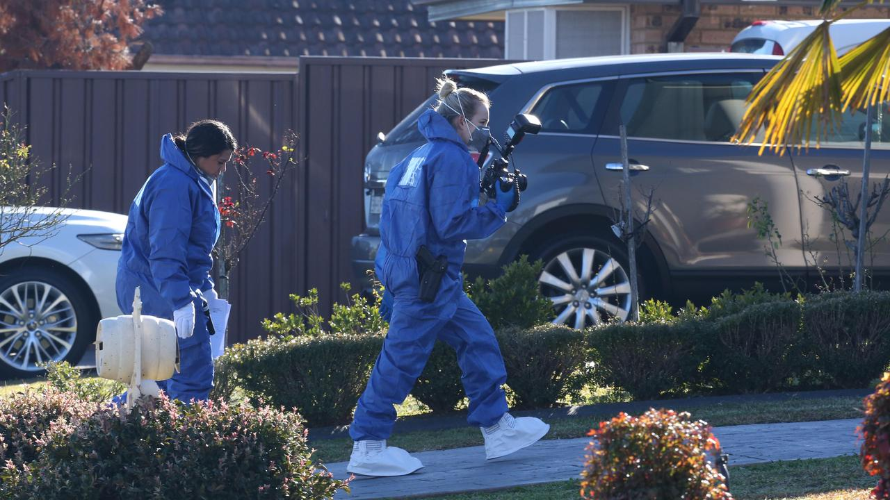 Forensic officers arrive at the St Clair house yesterday morning. Picture: David Swift.